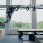 Atlas robot does broad jump.